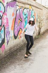Woman on cruiser at graffiti