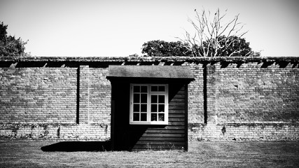 Garden hut against a wall at English stately home