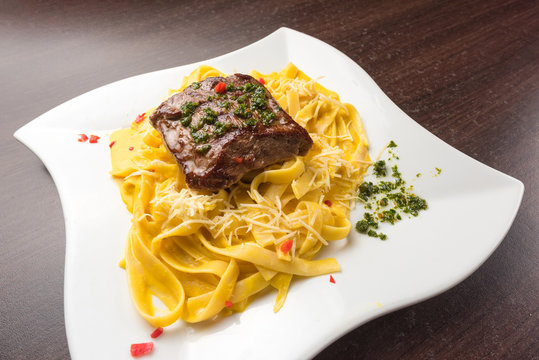 Peruvian food: Fetucinni with huancaina sauce and grilled beef.