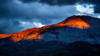 Maritime Alps in South of France illuminated by dramatic sunset light and skies