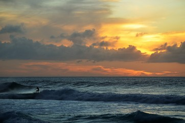 Surfers sunset