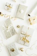 Golden gift boxes, decorations on white background. Flat lay, top view Christmas, New Year holiday gifts packaging concept.