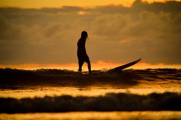 silhouette of surfboard player in the sunset (actual short)