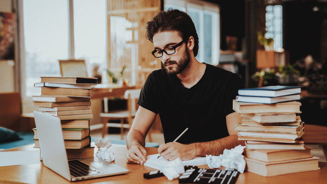 Pensive Freelance Text Writer Working at Desk