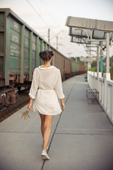 Young woman waiting for someone on train station