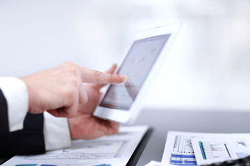 close up.businessman using digital tablet in the workplace