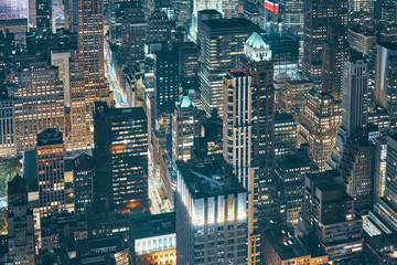 New York City at night, view from the Empire State Building, color toned picture, USA.