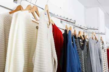 Clothes on hangers and shelfs in boutique