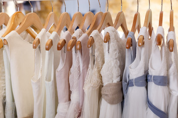 Kids white dresses on hangers