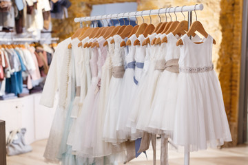 Kids white dresses on hangers