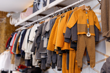 Stand with many baby costumes