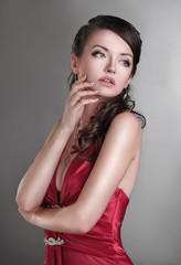 ambitious beautiful woman in a red dress.isolated on dark