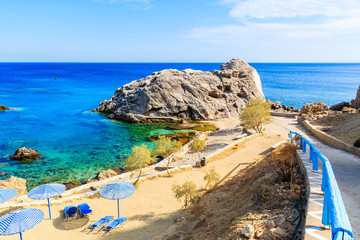 Fototapete - Beautiful bay with beach in Ammopi village on sea coast of Karpathos island, Greece