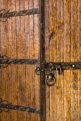 brown wood old door with iron hardware
