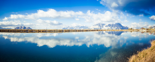 Image of mountain panorama with water reflections in lake