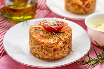 Tasty tomato rice with cheese and tomato sauce