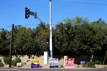 Campaign signs for Arizona U.S. senatorial candidates Krysten Sinema and Martha McSally are seen at an intersection following the U.S. Midterm elections in Scottsdale, Arizona