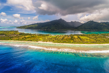 Staande foto Oceanië Aerial French Polynesia luxury travel honeymoon destination. Beach vacation at motu island of Huahine, Tahiti, Oceania adventure. View from above of paradise, French Polynesia, South Pacific Ocean.