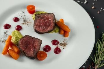 Beef roast on white plate