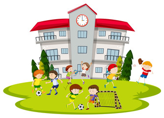 Boys playing football at school