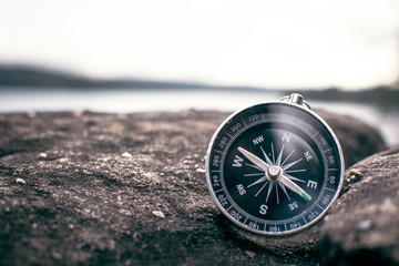 compass on rock in the nature, color vintage style