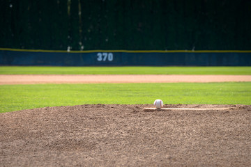 Baseball on Pitcher's Mound and 370 Yard Fence
