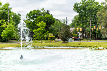 LeGrande park in Montgomery, USA during green spring in Alabama capital city during day with water fountain stream spraying up