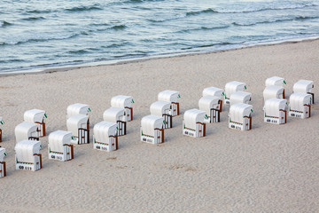 hooded beach chairs at the baltic sea coast on Ruegen, Germany