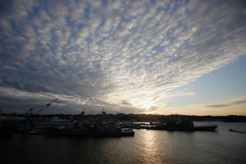 U.S. Navy vessels are seen at dusk at the U.S. naval base in Yokosuka