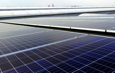 Solar PV Rooftop System in City Area Pagoda Background