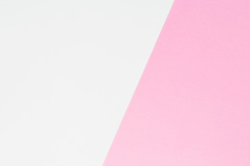 White and pastel pink background. Flat lay. Top view. Colorful texture