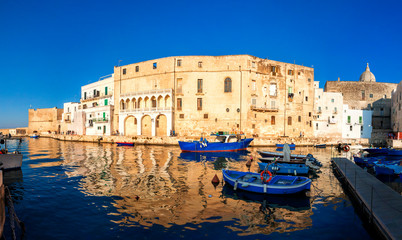 Old port of Monopoli province of Bari, region of Apulia, southern Italy. Boats in the marina of Monopoli. Fotomurales