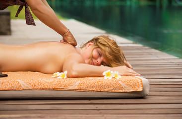 Woman enjoying authentic thai full body massage