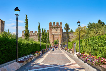 "Gate of Lion of Saint Mark at city of Lazise with Castle ""Scaligeri"" at Lake Garda in Italy"