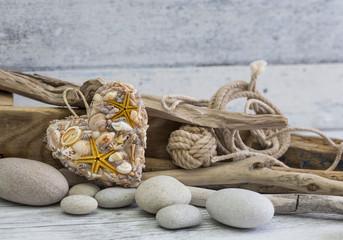 Fototapeta Beach still life with shell heart, pebble and driftwood obraz