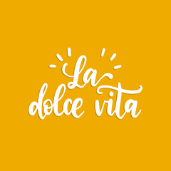 La Dolce Vita translated from Italian The Sweet Life handwritten phrase on yellow background. Vector inspirational quote