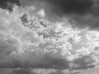 Grey sky with white and black cloud