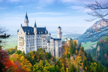 Picturesque autumn view of the Neuschwanstein castle. 19th-century Romanesque Revival palace near Füssen in southwest Bavaria, Germany. The famous popular tourist attraction of Europe