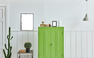 Close up green cabinet with frame and lamp decoration.