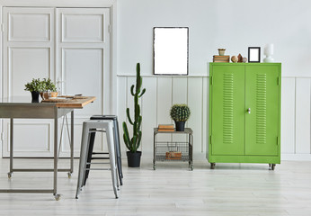 White background wall green cabinet and table style.