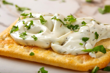 Salted biscuit with cheese cream and herbs