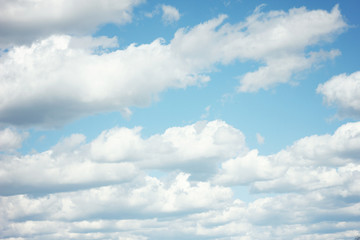 fluffy clouds.Closeup blue sky and fluffy clouds background.Aerial view on white fluffy clouds.light clouds in sky - abstract background