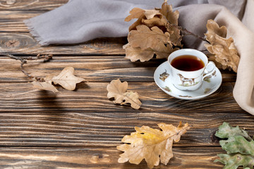 cup of tea and leafs on wooden table