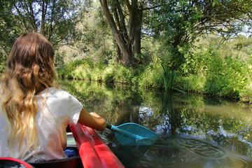 Girl paddle in Spreewald, Germany