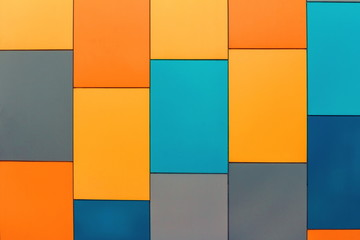Wall from multi-colored panels background.
