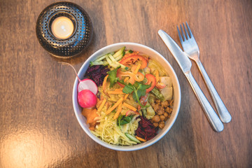 view of a bowl with delicious colorful tasty salad