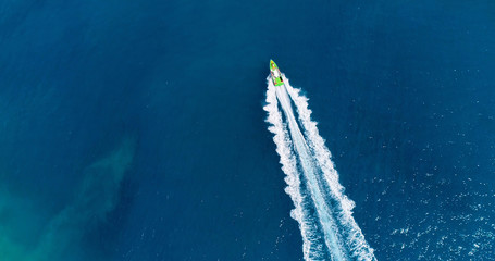 boat in a lagoon in French Polynesia, in aerial view
