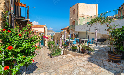 Wall mural Historic village of Castellammare del Golfo with terrace, bar and restaurant in Sicily, Italy