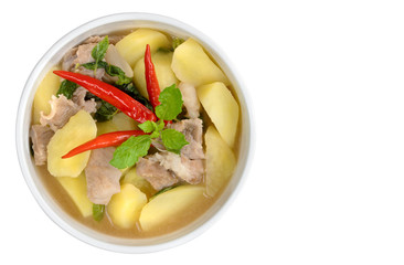 Potato soup with sliced pork and hot chilli in white background with clipping path,Thailand food