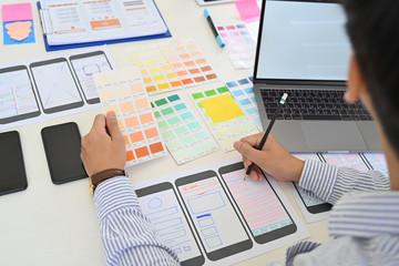 Wall Mural - UI Designer drawing website UX layout app development.